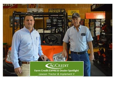 Tom Zack Evans (Ag Credit) with Ron Spalding (Lawson Tractor & Implement II)